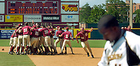 TALLAHASSEE, FL. 6/8/08-Florida State celebrates beating Wichita State 11-4 to advance to the College World Series as a Shocker walks off the field after NCAA Super Regional action Sunday at Dick Howser Stadium in Tallahassee. FSU has never won the CWS and it has been eight years since their last trip to Omaha. COLIN HACKLEY PHOTO
