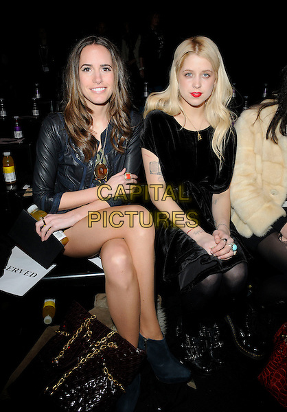LOUISE ROE & PEACHES GELDOF .At the PPQ Fashion Show during London Fashion Week - Day 2 , BFC Show Space, Somerset House, London, England, UK, February 20th 2010..LFW full length sitting front row black dress velvet ankle boots leather .CAP/CAN.©Can Nguyen/Capital Pictures