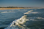 Surfer riding on waves at Pismo Beach, California