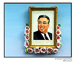 NR00744 /  Portrait of Kim Il Sung, exposed for the annual anniversary of his birth 15 April. Although he deceased in 1994, he remains the President for Life of North Korea. This year North Koreans will celebrate the 10th anniversary of his death.....Bien qu'il soit decede en 1994, il demeure le President a Vie de la Coree du Nord. Cette annee, les Nord-Coreens celebrerons le 10ieme anniversaire de sa mort...Pyongyang, Coree du Nord, Septembre 2001..©Nicolas Righetti/Rezo