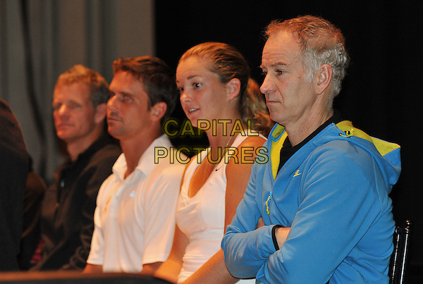 "Legendary tennis player JOHN McENROE joins his fellow tennis players on stage for a charity auction before the annual ""World TeamTennis Smash Hits"" charity night of tennis in Cleveland for the first time in the event's 19-year history held at Public Hall, Cleveland, OH, USA..October 27th, 2011       .half length arms crossed top nike black blue side profile.CAP/ADM/JN.©Jason L Nelson/AdMedia/Capital Pictures."