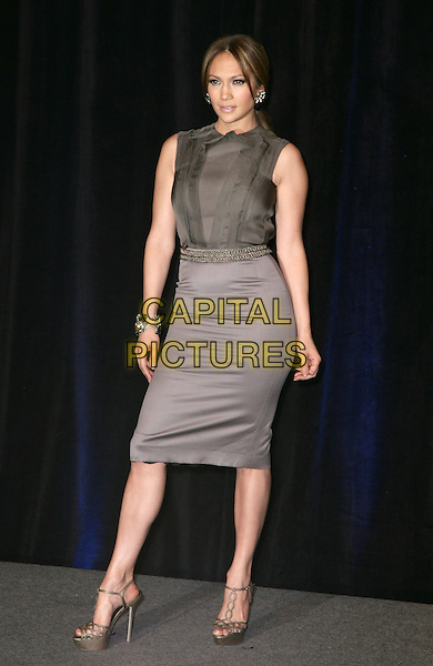 JENNIFER LOPEZ.CBS Films ShoWest Luncheon at the Paris Resort Hotel and Casino,  Las Vegas, Nevada, USA,.18th March 2010..full length grey gray pencil skirt  sleeveless top blouse brown ruffle ruffles gold belt waist waistband platform shoes heels sandals bracelet .CAP/ADM/MJT.© MJT/AdMedia/Capital Pictures.