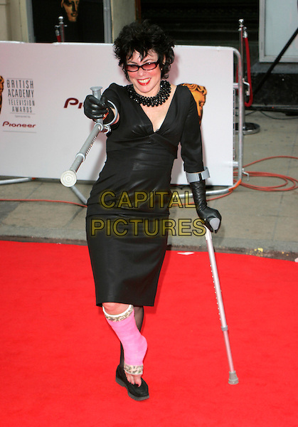 RUBY WAX.Red Carpet Arrivals at The British Academy Television Awards (BAFTA's) Sponsored by Pioneer, held at the London Palladium, London, England, May 20th 2007. .full length black glasses on crutches injured foot pink cast  plaster funny walking sticks.CAP/AH.©Adam Houghton/Capital Pictures.