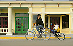Market street Mackinac Island. Father and daughter cycling.