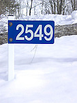 Rural; municipal; residence sign; 911; winter; snow