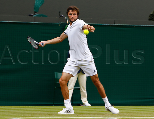30.06.2016. All England Lawn Tennis and Croquet Club, London, England. The Wimbledon Tennis Championships Day Four Grigor Dimitrov (Bul) hits a forehand during his singles match against number 16 seed, Gilles Simon (FRA).
