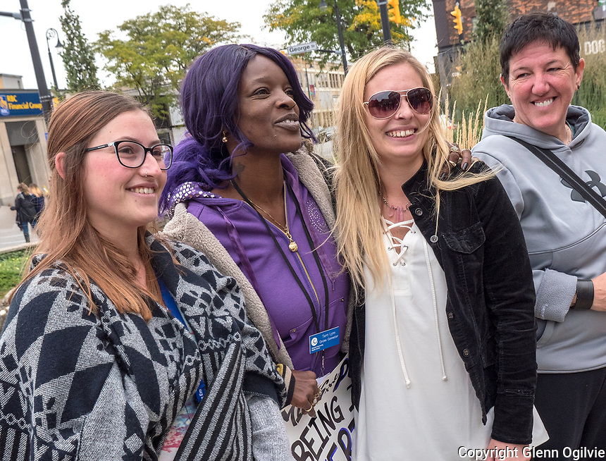 The Stand Up Against Poverty Rally was held at City Hall organized by the Lambton College Centre for Social Justice. Among those taking part in the rally, all members of the Circles program, are from left; Lauren Duncan, Terri Lynne Sullivan, Tasha Barwise, a speaker at the rally and coach Martine Creasor.