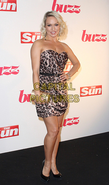 KRISTINA RIHANOFF.The Sun's new magazine 'Buzz' launch at Il Bottacio, London, England. .September 15th, 2010 .full length black dress gold clutch bag brown beige leopard print dress clutch bag strapless hand on hip.CAP/JIL.©Jill Mayhew/Capital Pictures