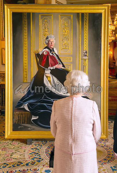 14 October 2016 - Windsor, Berkshire, UK - Queen Elizabeth II views a portrait of herself by British artist Henry Ward, marking six decades of patronage to the British Red Cross, which has been unveiled at Windsor Castle in Berkshire. The Queen is the longest-serving patron of the charity, which supports people in crisis in the UK and overseas. Photo Credit: Alpha Press/AdMedia