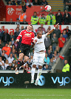 Pictured L-R: Wayne Rooney of Swansea heads the ball over Ashley Williams of Swansea Sunday 30 August 2015<br />