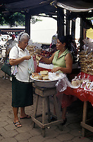 Woman buying bread in the Mercado Municipal, Masaya, Nicaragua
