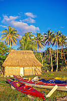 Sea kayaks by bure and palm trees, Yasawa Islands, Fiji