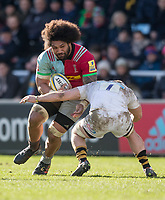 \Harlequins' Mathew Luamanu is tackled by Wasps' Thomas Young<br /> <br /> Photographer Bob Bradford/CameraSport<br /> <br /> Aviva Premiership Round 14 - Harlequins v Wasps - Sunday 11th February 2018 - Twickenham Stoop - London<br /> <br /> World Copyright &copy; 2018 CameraSport. All rights reserved. 43 Linden Ave. Countesthorpe. Leicester. England. LE8 5PG - Tel: +44 (0) 116 277 4147 - admin@camerasport.com - www.camerasport.com