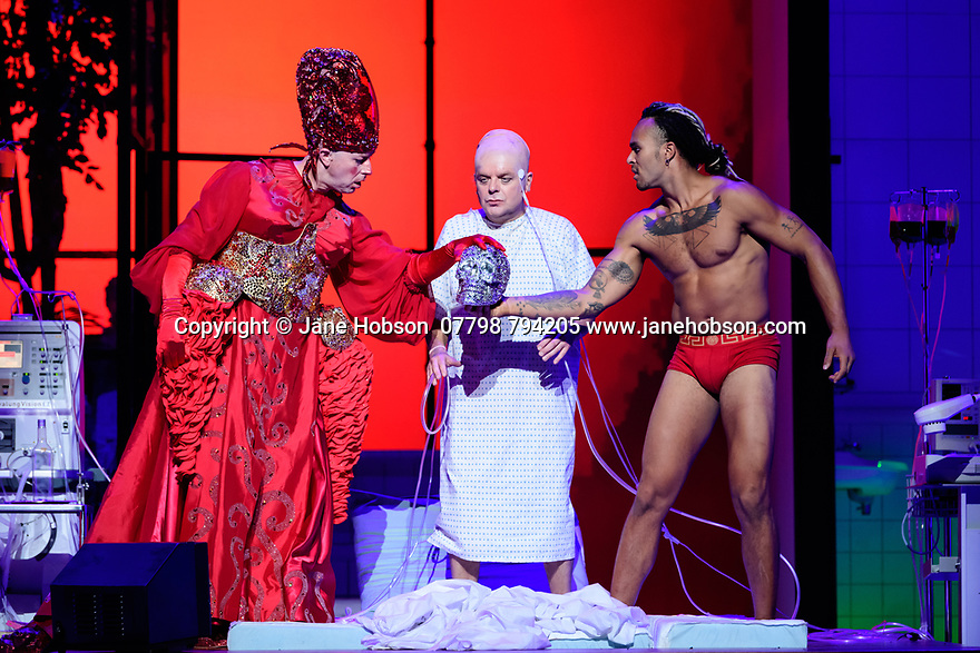 """EMBARGOED UNTIL 23:00 FRIDAY 18 OCTOBER 2019: English National Opera presents """"The Mask of Orpheus"""", by Sir Harrison Birthwhistle, libretto by Peter Zinovieff, at the London Coliseum, in its first London restaging in the 30 years since its premiere, coinciding with the celebration of Sir Harrison's 85th birthday. Directed by Daniel Kramer, with lighting design by Peter Mumford, set design by Lizzie Clachan and costume design by Daniel Lismore. Picture shows: Daniel Norman (Orpheus the Myth), Peter Hoare (Orpheus the Man), Matthew Smith (Orpheus the Hero)"""