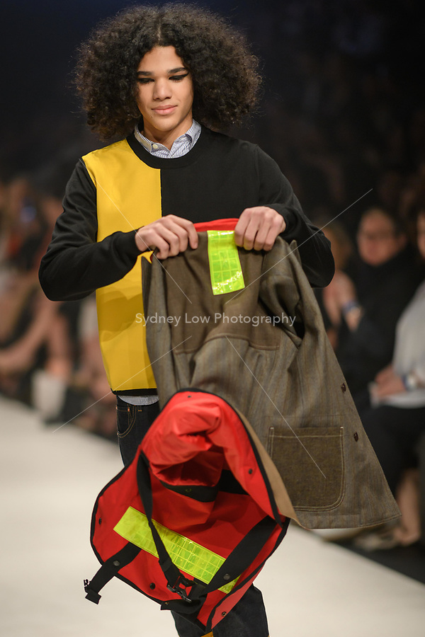 Melbourne, September 7, 2018 - A model wearing clothing from retailer Masons walks at the Town Hall Closing Runway show in Melbourne Fashion Week in Melbourne, Australia. Photo Sydney Low