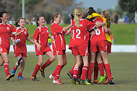 The Mokoia team celebrates winning their girls' football match against Te Puke during the AIMS games at Bay Arena in Mount Maunganui, New Zealand on Thursday, 14 September 2017. Photo: Dave Lintott / lintottphoto.co.nz