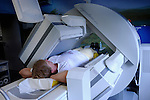Patient lying in x-ray unit ( gamma camera )
