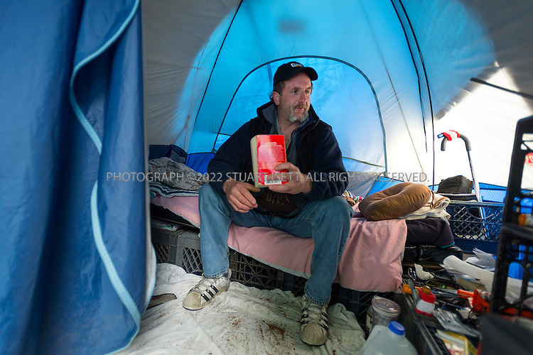 5/18/2012--Seattle, WA, USA..Rick, 46, originally from Fall City, WASH., now a resident at Tent City 3...SHARE/WHEEL's Tent City 3, a self-managed homeless community, is at St Mark's Episcopal Cathedral in Seattle where it will remain until mid-June. Overseen by SHARE/WHEEL, a nonprofit Seattle-based homelessness advocacy group, the tent city is part solution to homeless persons? need for shelter and part ongoing PR effort to keep the homelessness issue in the public eye...Every January in King County, WASH.,, volunteers count the number of people living outdoors in green spaces, under bridges and in alleys. In 2006, according to the nonprofit Seattle/King County Coalition on Homelessness, the ?One Night Count? found 1,946 people living on the street. This year, the number was up to 2,594, although it has fallen from its peak of 2,827 in 2009. And according to the U.S. Department of Housing and Urban Development (HUD), total homelessness in Seattle and King County rose 14.1 percent between 2006 and 2010. ...©2012 Stuart Isett. All rights reserved.