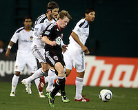 Dax McCarty (10) of D.C. United is pushed in the back by David Beckham (23) of the Los Angeles Galaxy during an MLS match at RFK Stadium, on April 9 2011, in Washington D.C.The game ended in a 1-1 tie.