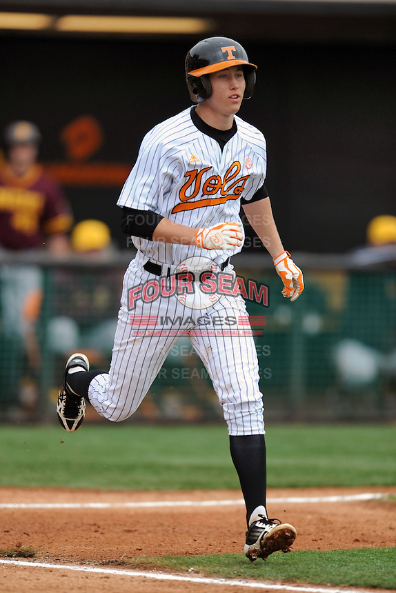 Tennessee Volunteers shortstop A.J. Simcox #10 runs to first during a game against  the Arizona State Sun Devils at Lindsey Nelson Stadium on February 23, 2013 in Knoxville, Tennessee. The Volunteers won 11-2.(Tony Farlow/Four Seam Images).