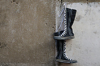 Almost Black and White, Boots hanging on the wall near the local shoe maker.Colombo Sri Lanka Street Photography