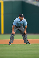 Third base umpire Robert Moreno during the International League game between the Norfolk Tides and the Charlotte Knights at BB&T BallPark on April 9, 2015 in Charlotte, North Carolina.  The Knights defeated the Tides 6-3.   (Brian Westerholt/Four Seam Images)