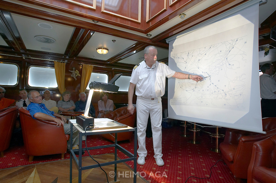 "The ""Lili Marleen"" (luxurious sailing ship of Deilmann Cruises). Captain Axel Rittig giving the weather and routing update to passengers."