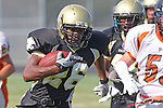 Palos Verdes, CA 09/22/11 - James Nelson (Peninsula #26)) in action during the Beverly Hills-Peninsula Varsitty Football gane.