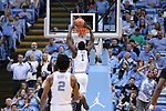 CHAPEL HILL, NC - DECEMBER 03: North Carolina's Theo Pinson dunks the ball. The University of North Carolina Tar Heels hosted the Tulane University Green Wave on December 3, 2017 at Dean E. Smith Center in Chapel Hill, NC in a Division I men's college basketball game. UNC won the game 97-73.