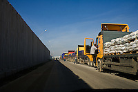 Kerem Shalom, Jan 05 2009.More than 100 trucks loaded with humanitarian aid wait to be unloaded outside the terminal. Very few Palestinian trucks showed up on the other side as a result of Israel's ground attack on Gaza.