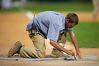 Grounds Crew member gets the field ready for a Pitt Panthers game against the Ohio State Buckeyes on February 20, 2016 at Holman Stadium at Historic Dodgertown in Vero Beach, Florida.  Ohio State defeated Pitt 11-8 in thirteen innings.  (Mike Janes/Four Seam Images)