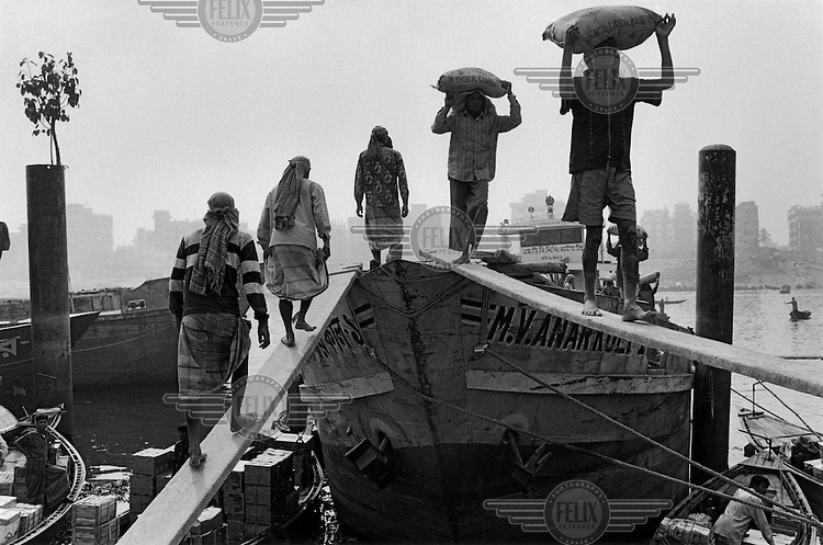Loading a ship on Buriganga River.