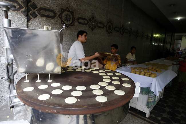 A Palestinian vendor prepares qatayef, a popular sweet during Ramadan, in a shop in Gaza city on Aug.10, 2011. Muslims around the world are observing the holy fasting month of Ramadan where they refrain from eating, drinking, smoking and sex from dawn to dusk. Photo by Mahmud Nassar