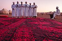 Africa, Marocco,berber men sing in te tendy camp in the desert in dune of Chegaga