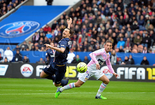 18.01.2015. Paris, France. French League 1 football. Paris St Germain versus Evian.  Zlatan Ibrahimovic (psg) challenged by Adrien Thomassin (etg)