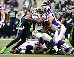 Minnesota Vikings running back Adrian Peterson, center,  is stopped after a short gain by Seattle Seahawks cornerback Brandon Browner ,left,  at CenturyLink Field in Seattle, Washington on  November 4, 2012.  Peterson rushed for 182 yards and scored two touchdowns in the Vikings 20-30 loss to the Seahawks.      ©2012. Jim Bryant Photo. All Rights Reserved.