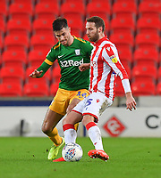 Preston North End's Andrew Hughes battles with Stoke City's Nick Powell<br /> <br /> Photographer Dave Howarth/CameraSport<br /> <br /> The EFL Sky Bet Championship - Stoke City v Preston North End - Wednesday 12th February 2020 - bet365 Stadium - Stoke-on-Trent <br /> <br /> World Copyright © 2020 CameraSport. All rights reserved. 43 Linden Ave. Countesthorpe. Leicester. England. LE8 5PG - Tel: +44 (0) 116 277 4147 - admin@camerasport.com - www.camerasport.com