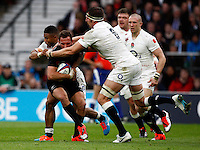 Photo: Richard Lane/Richard Lane Photography. England v New Zealand. QBE Autumn International. 08/11/2014. New Zealand's Aaron Cruden is tackled by England's Kyle Eastman and Tom Wood.