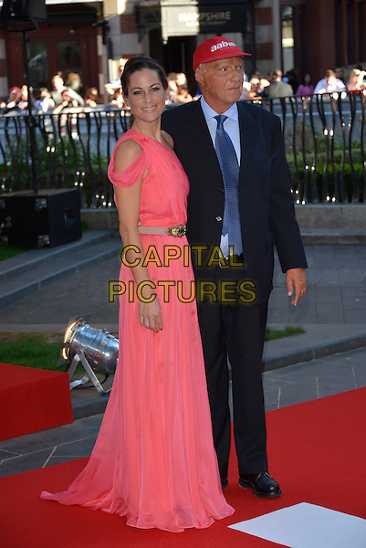 Birgit Lauda, Niki Lauda<br /> 'Rush' world film premiere at the Odeon Leicester Square cinema, London, England.<br /> 2nd September 2013<br /> full length pink dress blue suit red baseball cap hat married husband wife <br /> CAP/PL<br /> &copy;Phil Loftus/Capital Pictures
