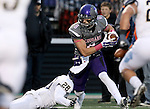 SIOUX FALLS, SD - OCTOBER 4: Josh Angulo #8 from the University of Sioux Falls tries to escape the grasp of Marc St. Louis #28 from Concordia St. Paul in the first half of their game Saturday evening at Bob Young Field.(Photo by Dave Eggen/Inertia)
