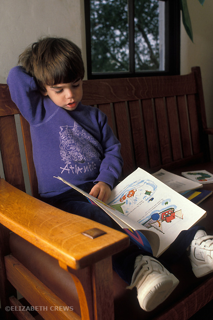 "Berkeley CA Boy, three-years-old, ""reading"" a book MR"
