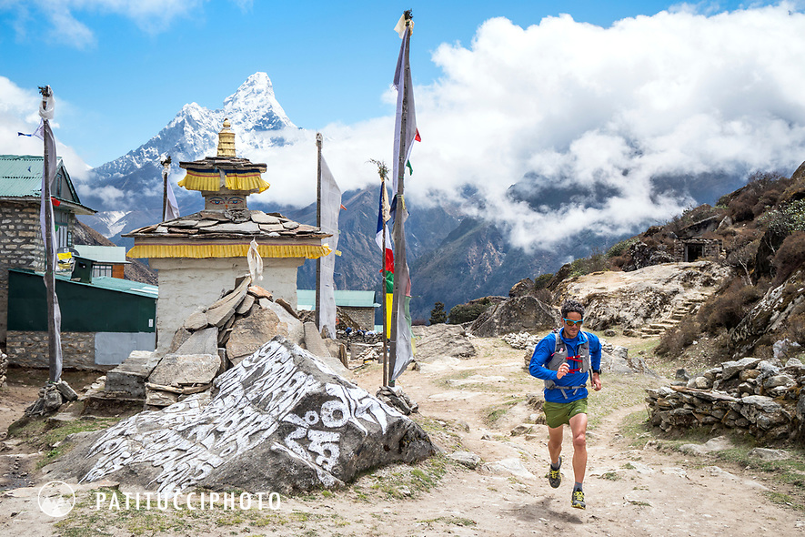 Trail running past a mani stone while passing through Khumjung, in Nepal's Khumbu Region.