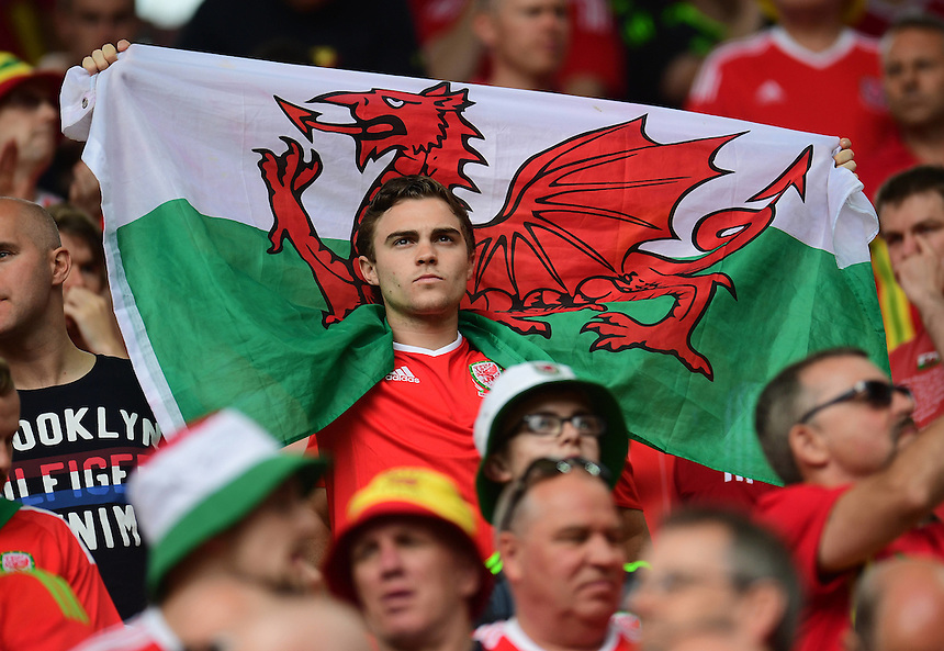 A Wales fan enjoy the pre-match build up<br /> <br /> Photographer Kevin Barnes/CameraSport<br /> <br /> International Football - 2016 UEFA European Championship - Group B - Wales v Slovakia - Saturday 11th June 2016 - Nouveau Stade de Bordeaux, Bordeaux<br /> <br /> World Copyright &copy; 2016 CameraSport. All rights reserved. 43 Linden Ave. Countesthorpe. Leicester. England. LE8 5PG - Tel: +44 (0) 116 277 4147 - admin@camerasport.com - www.camerasport.com