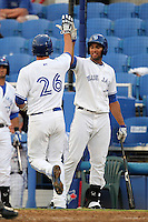 Dunedin Blue Jays outfielder Michael Crouse #21 greets Jake Marisnick #26 after hitting a home run during a game against the Tampa Yankees at Dunedin Stadium on April 28, 2012 in Dunedin, Florida.  Dunedin defeated the Yankees 6-1.  (Mike Janes/Four Seam Images)