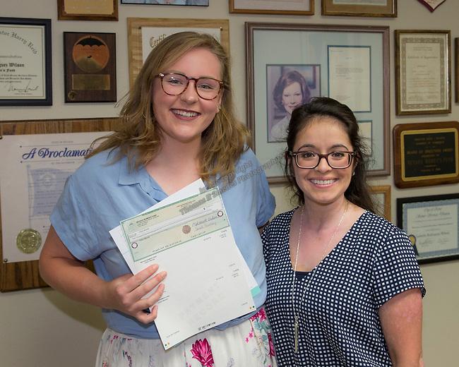 Gillian Mandel, left, and Board Member Jamii Uboldi during the Nevada Women's Fund Scholarship distribution, June 20, 2019.