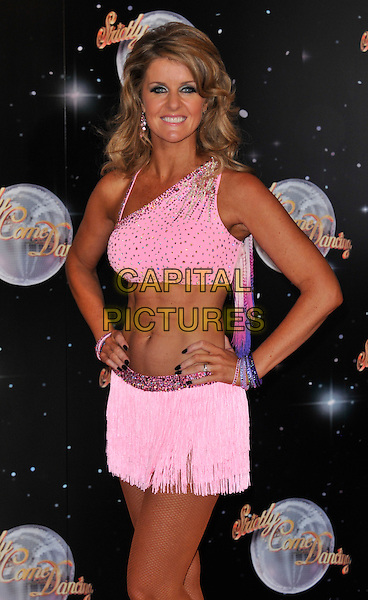Erin Boag.The Strictly Come Dancing 2012 Launch at the BBC, Wood Lane, London, England..September 11th, 2012 .half length fringed  pink cropped top skirt hands on hips one shoulder strap belly stomach midriff .CAP/WIZ.© Wizard/Capital Pictures.