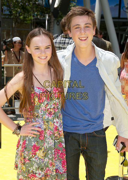 "MADELINE CARROLL & STERLING BEAUMAN.""Despicable Me"" Los Angeles Premiere at the Los Angeles Film Festival 2010 held at Nokia Theatre LA Live, Los Angeles, California, USA..June 27th, 2010.half length floral print dress pink green red hand on hip blue white shirt beaumon.CAP/ADM/BP.©Byron Purvis/AdMedia/Capital Pictures."