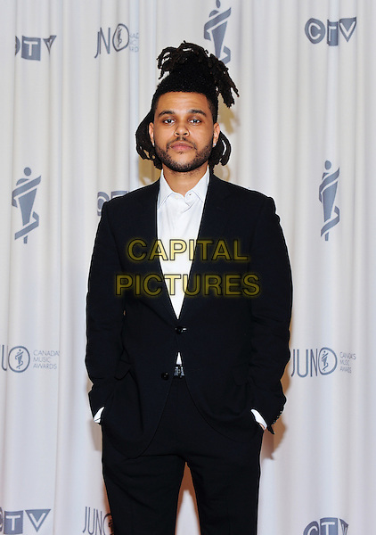 15 March 2015 - Hamilton, Ontario, Canada.  The Weeknd poses backstage in the press room during the 2015 JUNO Awards at FirstOntario Centre. <br /> CAP/ADM/BPC<br /> &copy;Brent Perniac/AdMedia/Capital Pictures