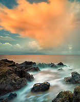 Sunrise and clouds on rocky beach. Maui, Hawaii