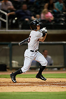 Birmingham Barons right fielder Ryan Brett (15) follows through on a swing during a game against the Pensacola Blue Wahoos on May 8, 2018 at Regions FIeld in Birmingham, Alabama.  Birmingham defeated Pensacola 5-2.  (Mike Janes/Four Seam Images)